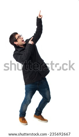 full body young man pointing up over white