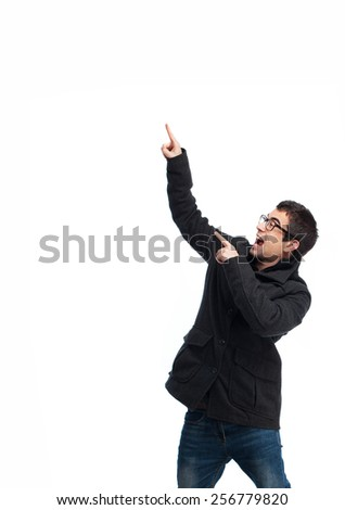 full body young man pointing up over white - stock photo