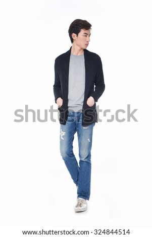 Full body young man standing in jeans walking on white background - stock photo