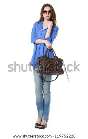 Full body Young stylish slim in jeans with handbag posing - stock photo