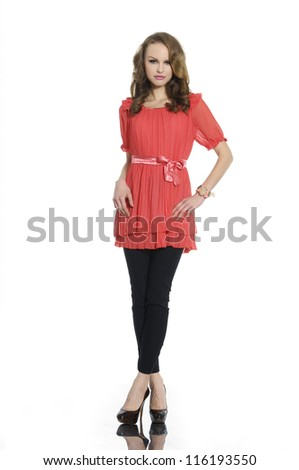 Full body young woman in casual clothes posing for the camera - stock photo