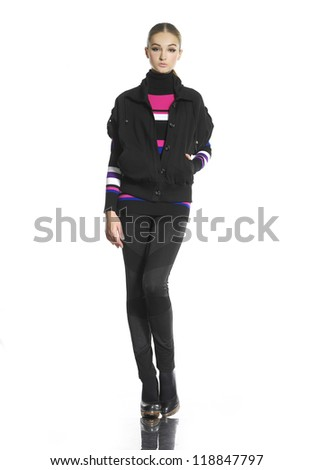 Full body young woman in casual clothes posing for the camera over white background