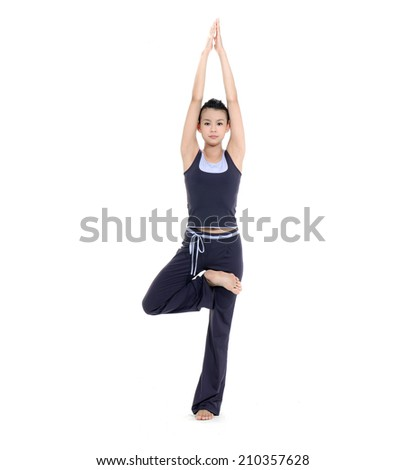 Full body young woman stand in yoga pose - stock photo