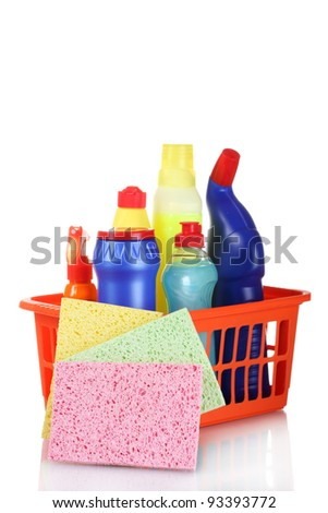 full box of cleaning supplies and sponges isolated on white