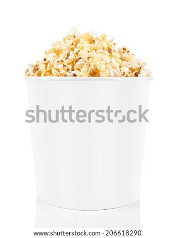 Full bucket of popcorn isolated on white background - stock photo