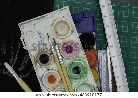 full color of watercolor paint tray with brush.