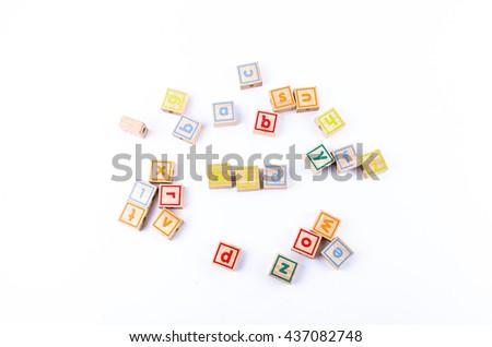 Full color Wooden toy blocks deployed kid on white background - stock photo