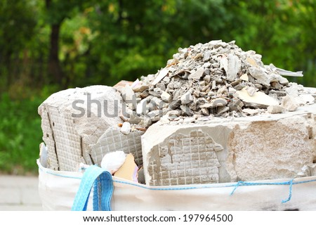 Full construction waste debris bags, garbage bricks, pile of rubble and material from demolished house - stock photo