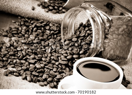 full cup of coffee, pot on beans and sacking - stock photo