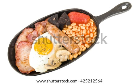 Full English Breakfast - Traditional English fry-up with egg, bacon, mushrooms, tomatoes, sausage, black pudding and baked beans.  - stock photo