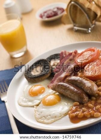 Full English Breakfast with Orange Juice Toast and Jam - stock photo