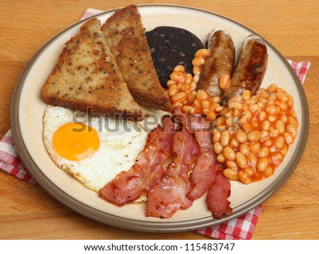Full English cooked breakfast with bacon, sausages, egg, black pudding and baked beans.