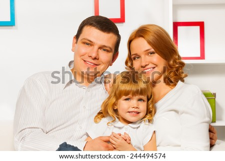 Full family portrait with girl mother and father - stock photo