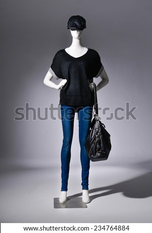 Full female black clothing in jeans with black hat ,scarf on mannequin on light background - stock photo