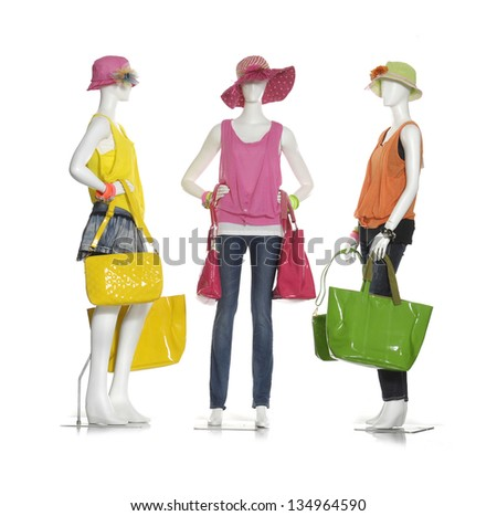 Full female clothes in jeans with three colorful clothes, hat ,bag on three mannequin - stock photo