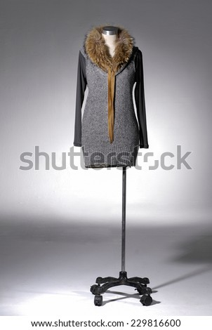 Full female clothing on mannequin on light background  - stock photo