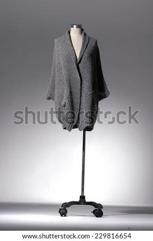 Full female clothing on mannequin on light background - stock photo