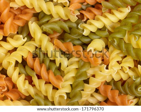full frame background with lots of milticolored fusilli noodles