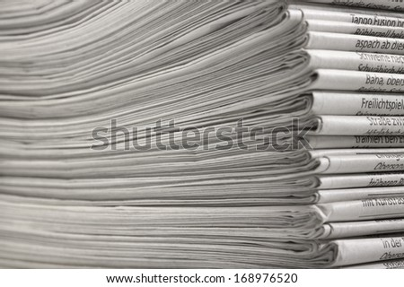 full frame background with lots of stacked newspapers