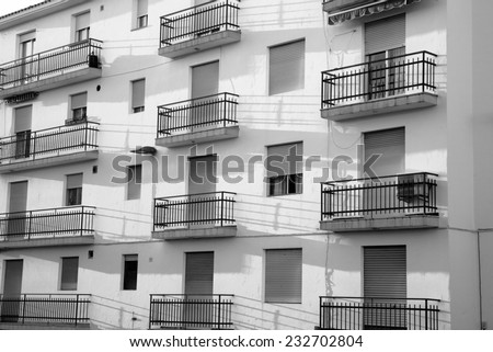 Full frame black and white take of a shabby apartment block - stock photo