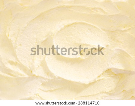 Full Frame Close Up of Banana Ice Cream, Swirled White Cream Colored Ice Cream Treat - stock photo
