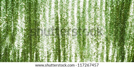 Full frame green sequins curtain background texture.