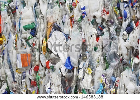 Full frame image of compacted rubbish at recycling plant - stock photo
