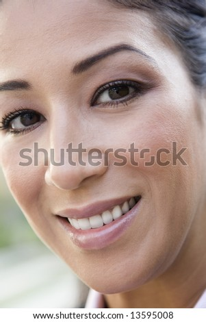 Full frame portrait of woman smiling to  camera