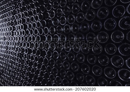 Full frame shot of bottles in wine cellar - stock photo