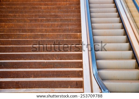 Full frame take of a staircase next to an escalator - stock photo