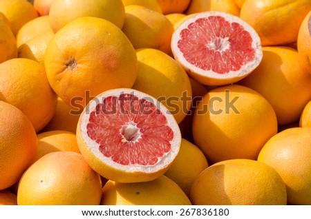 Full frame take of many grapefruit on a street market stall - stock photo