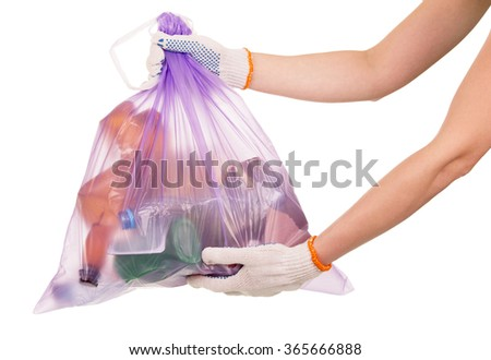Full garbage bag in her hands closeup isolated on white background - stock photo