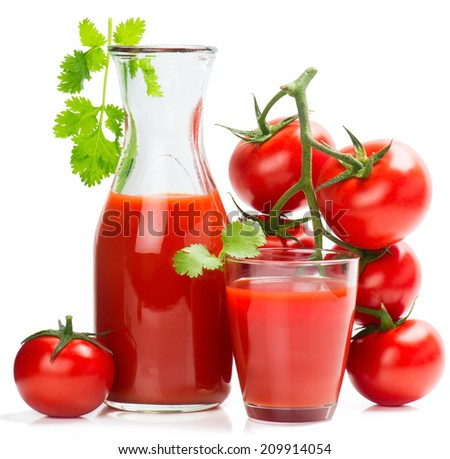 Full glass and bottle of tomato juice and whole tomatoes isolated on a white.