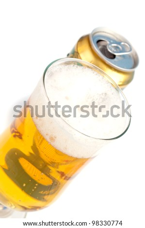 Full glass of beer and can - stock photo