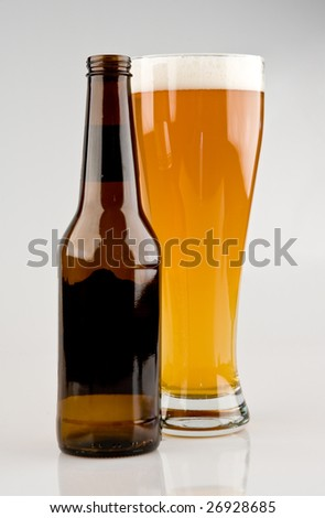 Full Glass of Beer with Bottle - stock photo
