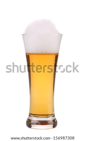 Full glass of beer with foam. Isolated on a white background.