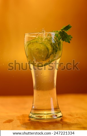 Full glass of fresh cool tonic with lime fruits isolated on background - stock photo