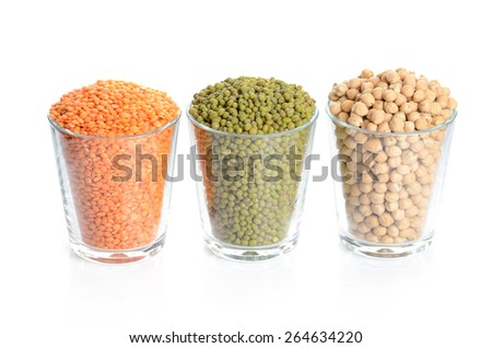 full glasses with mung, lentil and chick-pea isolated on white