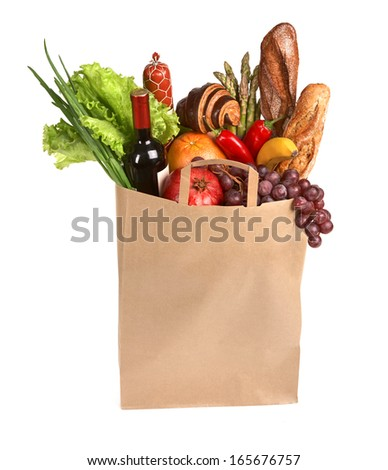 Full grocery bag / studio photography of brown grocery bag with fruits, vegetables, bread, bottled beverages - isolated over white background
