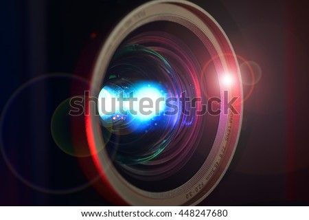 FULL HD video Projector lens close-up with lens flare - stock photo