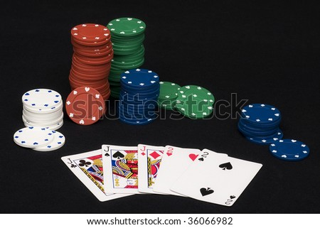 Full house hand in playing poker with chips