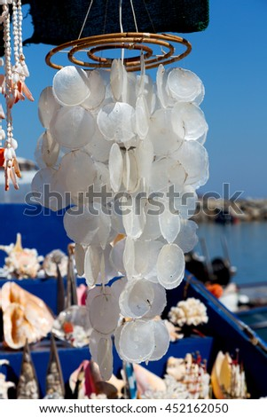 full in market old table shell and sealife in sale chandelier - stock photo