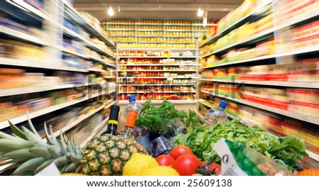 Full inkaufswagen with fruit vegetable food in supermarket - stock photo