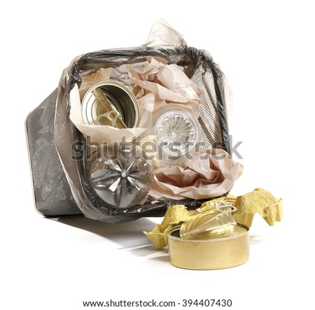 Full inverted garbage basket, isolated on white - stock photo