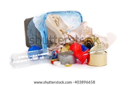 Full inverted garbage basket, isolated on white - stock photo