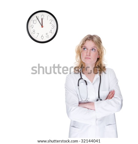 Full isolated portrait of a beautiful caucasian doctor looking at the clock - stock photo