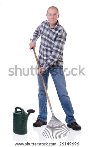 Full isolated studio picture from a young  gardener with a rake and watering can - stock photo
