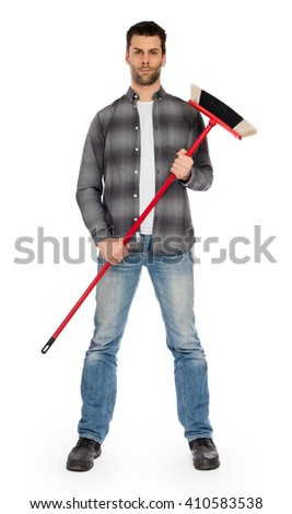 Full isolated studio picture from a young worker with a broom - stock photo