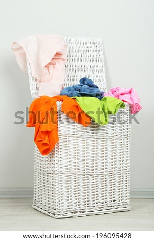 Full laundry basket on gray background
