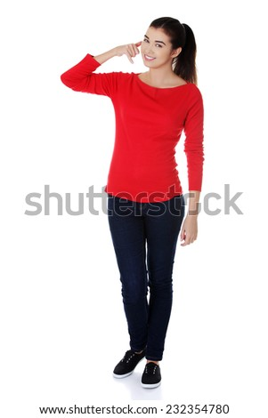 Full legth woman making a call me gesture. - stock photo